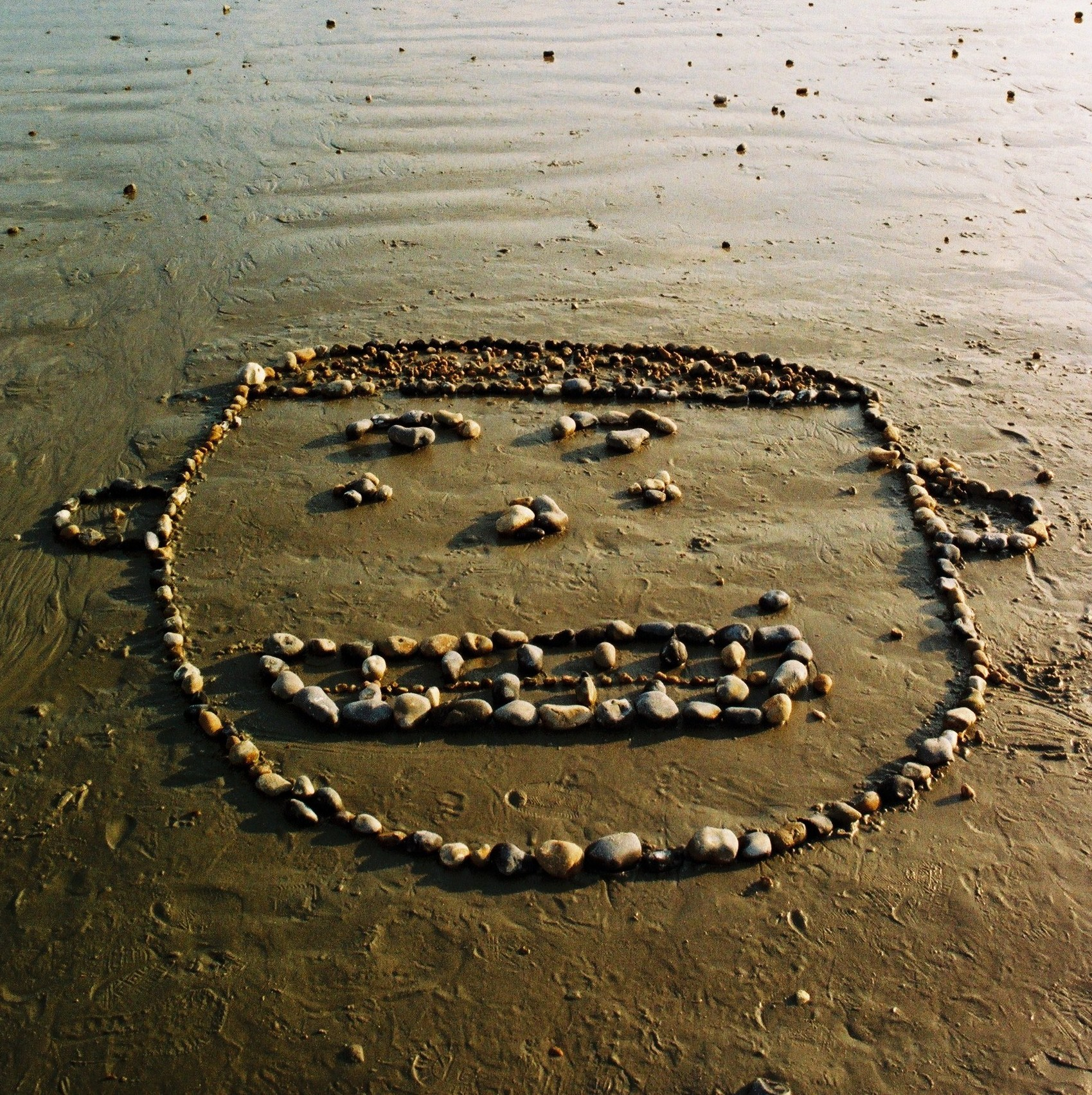 smiley face made of pebbles